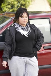 Overweight woman smoking